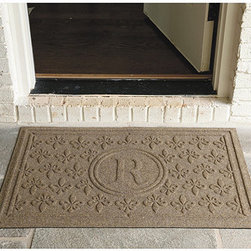 Ballard Designs - Fleur De Lis Doormat Personalized - Lower profile for easy door clearance. Made in the USA. The textured, high/low Fleur-de-Lis weave acts as a scraper, removing dirt while it wicks away moisture, keeping indoor floors and outdoor floors in covered areas cleaner and drier. Woven of washable, fade, mildew and stain-resistant polypropylene with durable rubber backing. For Personalized style, specify letter. Personalized Fleur-de-Lis Mat features: . .