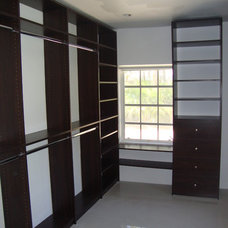 Clothes And Shoes Organizers by Chio's Interior Designs