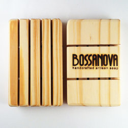 BOSSANOVA - PINE SOAP DISH - Our 100% Pine soap dishes  are fire branded with the BOSSANOVA logo and are designed to drain water away and out of the dish allowing the soap to dry quickly, and last longer.  BOSSANOVA soap dishes are made from only abundantly sustainable Pine trees planted to be harvested as an eco-friendly wood resource. Smooth to the touch, our dishes are 100% chemical free with no sprays, lacquers, finishes, coatings or glues.  Made using a solid one-piece construction, these dishes hold up well in wet conditions. Expect to see occasional knotholes, blemishes, light and dark grains, and other naturally occurring characteristics as well as some variation in branding that add character to each and every BOSSANOVA soap dish.