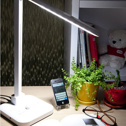 Frontgate - Brown Light LED Desk Lamp with Bluetooth Technology - Four light spectrums with 5-step brightness control. Lasts 40 times longer than an incandescent bulb. Consumes 75% less power than a typical fluorescent light. Built-in USB charging port can charge an iPod, mobile phone, MP3 player and more. Timer allows for automatic turn-off after one hour. Our eco-friendly Natural Light LED Desk Lamp provides four distinct light spectrums for stress-free productivity--and it uses 10 watts or less of power to provide this superior light. Reading mode stimulates concentration and reduces eyestrain with mid-range color; study mode increases attention and concentration of high range color temperature; relaxation mode promotes relaxation and improved mood with low-range color temperature; bedtime mode encourages a deep sleep with comfortable soft light. This light has enhanced functions of Bluetooth, FM radio and an automatic timer. With several great technical features, this lamp is perfect for any desk in an office or school, or for a bedside table.  .  .  .  .  . Bluetooth for iPod, iPhone and Android phones . Call button allows you to mute music to take a call .