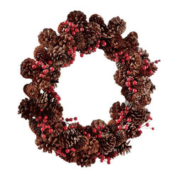 Pinecone and Berry Wreath - Welcome the holiday home. Decorative wreath is hand-crafted from natural pinecones and twigs, accented by faux berries, on a durable wire and plastic base. Looks great on a front door or hung the wall of your favorite room. A wreath is an easy way to update your home décor for the holiday.