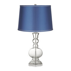 Color Plus - Clear Fillable - Satin Blue Shade Apothecary Table Lamp - This apothecary-style Clear Fillable designer glass table lamp features a stylish blue satin drum shade. The apothecary style glass table lamp offers a wonderful style accent. The clear glass base can be filled with your favorite collectible - from seashells to glass beads, the possibilities are endless! The design features a clear lucite base and is topped with a stylish blue satin drum shade. Lamp base U.S. Patent # 8,899,798.