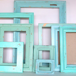 Beach-Themed Picture Frames, Robin's Egg Blue, by Dirt Road Decor - Painting picture frames all one color is such a great way to unite your space. Fill them up or leave them empty; it's your call.