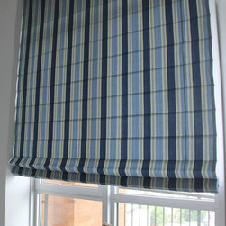 Ian in Williamsburg Solar Shades and Roman Shades - In the bedroom Ian wanted to get privacy and cut down on his light so he could sleep in.  He picked the repeating stripe to bring in several shades of blue and elongate the space.