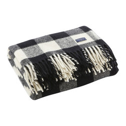 Fairbault Woolen Mill - Buffalo Check Wool Throw - White/Black - Based on the timeless buffalo check design, this lumberjack plaid pattern would make our fellow Minnesotan, Paul Bunyan proud. The 2x2 twill construction creates a distinctive diagonal pattern that brings out the intricacies of the design. This is your blanket if you're seeking an authentic outdoor look. Permanently moth-proofed, 100% pure wool. Dry clean only. Made in America.