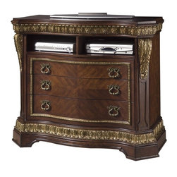 Pulaski - Pulaski Del Corto Media Chest - Del Corto is a fresh redesign of a traditional style to incorporate modern conveniences. Crafted using book matched cherry veneers, it&rsquos richly appointed acanthus leaf overlays, detailed urn finials, intricate moldings, and impressive shell motif crowns on the headboard and mirror are all elements of old world European elegance. Mouldings are detailed through a multi-step finish process and tipped with gold dry-brushing to create a regal antiqued appearance.