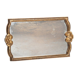 Gold Antiqued Mirror Rectangular Tray - Medium - Architectural details in its shaped walls frame the faintly romantic appeal of age-spotted mirror in the Gold Antiqued Mirror Rectangular Tray. This handsome piece is a uniform aging gold, and its glass center plays perfect host to barware essentials, decorative bottles, or coffee cups. Add elegance to all your serving and decorating presentations with this traditional gold tray.