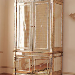 "Mirrored Armoire - This large mirrored armoire, designed with an antiqued silver finish, will command attention and be a gorgeous focal point wherever it is used.   Made of hardwoods with mirrored veneers.Double-hinged doors. 50""W x 27""D x 87""T.Additional information:Top cabinet has two drawers, removable clothes rod, and punch-out opening in back panel. Interior dimensions 44""W x 22""D x 51""T. Bottom cabinet has one adjustable shelf. Interior dimensions 45""W x 19""D x 22""T."