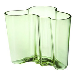 "iittala - Alvar Aalto Medium Apple Green Vase - A shape constantly interpreted, the Alvar Aalto collection of vases stays true to the original design concept. More than 70 years after the original debut, the design continues to provoke attention by letting the owner decide its use and complementing our busy lives with a touch of nature. Filled with fresh cut flowers or arranged with other collection pieces as works of art, this eternal classic is essential to the modern home. The Aalto glass pieces have a multi-stage production. The non-leaded crystal is first mouth blown before going into a wooden mold to create the classic Aalto shape. The pieces are then hand cut and go through several polishing and finishing steps before they are completed, creating a piece worthy of permanent display at the Museum of Modern Art. In addition to the standard Aalto colors, each year iittala selects two new glass colors to run in limited production. Features: -Mouth blown non-leaded crystal -Mouth-blown glass -Features designer's signature on the bottom -Not dishwasher safe, hand wash only -Overall dimensions: 4.75"" H"