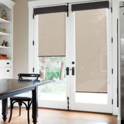 Window design ideas - Simple roller shades are beautiful and functional for French doors. Adding a slim tailored cornice sets the look as clean and organized.