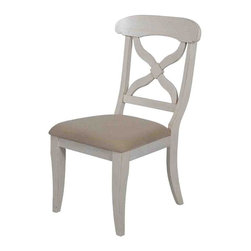 Sunset Trading - Eco-Friendly Side Chair - Traditional American farmhouse styles. Sturdy quality craftsmanship. Durable cloth material and high density polyurethane foam padding cushioned seat. Deep seated with contoured back. Criss-cross contoured back. Large backrest and seating area to provide ideal seating solution. Warranty: One year. Made from Malaysian oak. Antique white finish. Made in Malaysia. Assembly required. 21 in. W x 19 in. D x 38 in. H (12.61 lbs.)This beautifully designed furniture supplied by sunset trading will assure you many years of use and enjoyment. Invite an international touch of French country, British Caribbean into your home with this versatile dining chair from the sunset trading -andrews dining collection. Welcome guests into your home with the warmth and comfort of this classic timeless piece. Its versatile style will complement just about any decor in your home for years to come. Warm and inviting with a touch of casual elegance, the classic beauty and craftsmanship of this dining chair makes it equally appropriate for your kitchen or dining room fulfilling all your formal and informal dining needs. Pair this chair with coordinating andrews collection dining table to complete your dining experience.