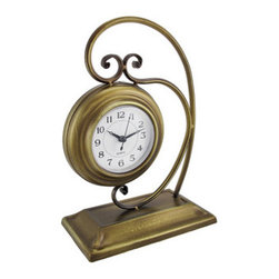 Antique Brass Finish Metal Desk or Table Clock 10 In. - This decorative metal clock adds a wonderful accent to any shelf, desk, or table in your home or office. It measures 10 inches tall, 7 3/4 inches long, 4 inches wide and has a lovely antique brass finish. The white clock face measures 3 1/4 inches in diameter and has easy-to-read black numbers and hands to show the time. The clock features quartz movement and runs on 1 AA battery (not included). This piece is sure to be admired, and makes a great gift for friends and family.