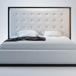 Ludlow Modern Bed - Modloft Furniture - The awe-inspiring Ludlow leather bed commands instant attention when entering a room. The lavish button-tufted leather headboard stands five feet tall, elegantly framed in a wood border to match any decor. The smooth leather headboard seamlessly blends into its matching leather base with a wood border along the bottom edge. The mattress sits snuggly atop a solid pine-slat base for stylistic durability and added comfort. Platform height measures 14 inches (3 inch inset). Available in California-King, Standard King, and Queen sizes. Color combinations available in Wenge/White, Wenge/Grey, or Walnut/White. Bonded leather material.