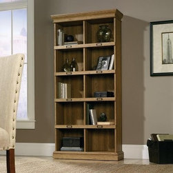 Sauder Barrister Lane Tall Bookcase - Scribed Oak - Tall and slim with plenty of storage space is what you get with the Sauder Barrister Lane Tall Bookcase - Scribed Oak. Ten cubbyholes provide storage that is ideal for books, binders, framed photos, decorative items, special keepsakes, and more. There are also places for ID label tags that are inventive and create a unique look.About SauderSauder is North America's leading producer of ready-to-assemble (RTA) furniture and the nation's fifth largest residential furniture manufacturer. Based in Archbold, Ohio, Sauder also sources furniture from a network of quality global partners, including a line of office chairs that complement its residential and light commercial office furniture. Sauder markets more than 30 distinct furniture collections in a full line of RTA furnishings for the home, entertainment, home office, bedroom, kitchen, and storage.Sauder is a privately held, third-generation, family-run business. The company prides itself on its awareness that all function and no fashion makes for a dull living space when it comes to home furnishing products. That's why Sauder's award-winning design team has produced more than 25 collections of stylish furniture that span the design spectrum. From minimalist modern or contemporary to classic 18th century or country styles, Sauder has what you're looking for. The company offers more than 500 items - most priced below $500 - that have won national design awards and generated thousands of letters of gratitude from satisfied consumers.