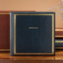 """Exposures - Stamford Extra Capacity Personalized Photo Album - Overview Crafted from bonded leather with luxe gold tooling on the cover, this Stamford extra-capacity personalized photo album has plenty of room to accommodate a large collection of photos. Mix and match page styles to create the perfect album for you. Gold stamped cover personalization available. (Up to 3 lines, 20 characters per line.) Features Goldtone extra-capacity 3-ring photo album Gold tooled borders on cover and spine Wrapped in bonded leather Lined in matching moir   Pages Holds up to 70 3-ring photo pages (6-7 sets) Choose your favorite page style Mix and match for a custom photo album  Photo pages sold separately    Personalization Gold-stamped cover personalization is available Up to 3 lines, 20 characters per line All capital letters only Matching personalized spine patches are available  Up to 2 lines, 7 characters per line All capital letters only No returns on personalized items unless the item is damaged or defective    Specifications 12"""" wide x 11 1/2"""" high   Shipping Please allow an additional 2-3 days for personalized items"""