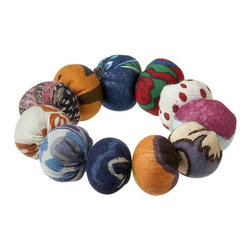 Sassari Napkin Ring - Every one of these unique, handmade napkin rings is a collection of rounds covered in a colorful pastiche of cotton sari fabrics. Originally intended for making wedding buttons, we've adapted them into an eye-catching dining accessory.