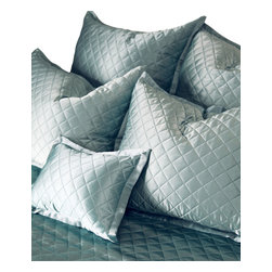 Quilted Pillow Sham - Euro - White - Put to rest any thoughts of ordinary: A jewel of a bedding accent, the Quilted Pillow Sham presents a diamond quilting pattern on 100% silk charmeuse. A soft lustre adds a whisper of elegance to bedscapes both modern and traditional, allowing for ease in blending with a range of textures, fabrics, and color palettes. The pillow sham backing is composed of a silk and cotton blend.