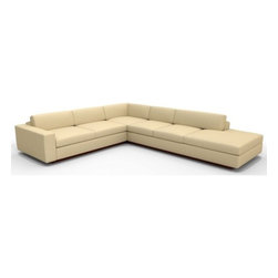 True Modern - Jackson Corner Sectional - The Jackson Corner Sectional Sofa with Bumper is a great addition to a modernist living room, family room or even an office setting. The bumper allows your sofa to bleed into the room without having the harsh and abrupt edge of the arm. There is no need for a side table on the bumper side of this sofa. The oversized seat, arms and pillows make it the ultimate lounger, but the clean design still keeps it modern and hip. The seat cushions are wrapped in down and the back pillows are stuffed with luxurious blend of feather and down as well. Our exclusive baffled system helps keep the feathers in place so you won't need to constantly fluff the pillows. Designed by: Edgar Blazona Features: -Material: 100% Polyester.-Durable and soft with a great multi tone texture.-Add an ottoman and really kick back.-Wooden base is hidden so the sofa really appears to be floating on air.-Low slanted back let's you lay back, stretch out and relax.-Jackson collection.-Collection: Jackson.-Distressed: No.-Country of Manufacture: United States.Dimensions: -Dimensions: 17'' - 28'' H x 114'' - 134'' W x 42'' D.