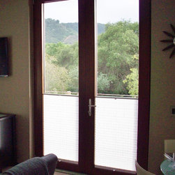 Contemporary Windows and Doors - Contemporary stainless steel exterior, with solid walnut interior. German turn and tilt hardware and spectrally selective coating. 25% more argon gas, low-e advanced coating, and 4 full gaskets.