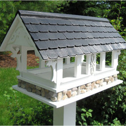 Covered Bridge Bird Feeder - White with Black Pine Shingled Roof - Add a bit of Americana to your yard with the fly-through Covered Bridge Bird Feeder. Perfect for any setting, this feeder is constructed of exterior-grade plyboard with scroll work trusses supporting a black, pine shingled roof, all finished with an outdoor paint. The large, open area can be filled with seed or can easily accommodate a piece of fruit for orioles to enjoy.