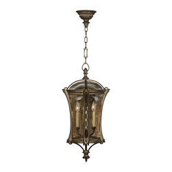 Fine Art Lamps - Gramercy Park Outdoor Lantern, 571882ST - This outdoor pendant lantern has an elegant, historic look, with its antique gold metal finish and handblown seedy glass panels. Two old-fashioned candelabra lights create an atmospheric glow that sparkles like gold dust through the textured, amber-tinted glass.