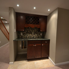 Traditional Basement by Basement Masters