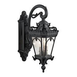 Kichler Lighting - Kichler Lighting 9357BKT Tournai Traditional Outdoor Wall Sconce - With its heavy textures, dark tones, and fine attention to detail, this 2 light outdoor wall fixture from the Tournai collection stands out from other outdoor fixtures. Handmade from cast aluminum, its distinctive Textured Black finish and Clear Seedy Glass panels give this piece a unique aged look.