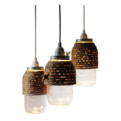 ecofirstart - The Hive - Set of 3 - Create a hive of activity in your kitchen, office or family room with this set of three bee-inspired pendant lights. Rope is crafted around mason jars to channel the honey-making homes of our yellow and black striped friends. These lights can sit on your table or be hung, either way they will create a buzz!