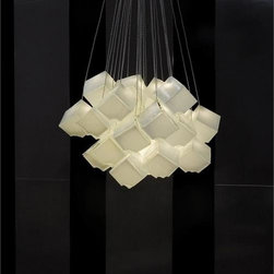 "Shakuff - Noga - White - An artful cluster of suspended White Glass dice. Glowing from within, each cube appears to melt right into the next.    Here are the options for creating your custom chandelier:    Noga comes in two sizes:     Small: 3-1/4"" x 3-1/4"" ($286 per light)   Large: 5-3/4"" x 5-3/4"" ($442 per light)   "" additional canopy costs may apply - see options below. Large size pendants can be clustered in 1-4 pieces, no more.  For larger clusters, please use small size pendants. ;     Glass colors available for Noga: Molten Red, & Milk.     Hardware Finishes: Antique Bronze, Dark Bronze, Matte Silver, Matte Black, and Matte White. Additional finishes are available for an up charge.    Glass cube hanging on a diagonal, with cutout on bottom corner. Small Size is best in clusters of 24 (with a single Galilee pendant ($364) in the center to add width).    Low voltage lighting  includes an electronic transformer and a CFL 25 watt max bulb for large  pendants and LED G4 1.6 watt bulb for small pendants. Five feet of  wiring comes standard with each pendant, and custom lengths are  available for $10 per additional foot.          Canopy Options & Pricing:     Up to 12 round or square with 7 lights or less - square add $170 to  the cost of pendants, round add $360 to the cost of pendants. Note-  Up to 18 round or square with 8 lights or more -  included in price of pendants    18-24 round or square with 16 lights or more -  included in price of pendants    24-36 round or square with 24 lights or more -  included in price of pendants Note-  Other shapes (rectangles, ovals, triangles, etc.) or any shape 36 and  larger, please call for price.Individual 5"" round canopies are also  available, add $150 to the cost of each pendant.     Please note that the price listed  pertains to a fixture that will appear very similar to the light shown  in the featured photograph and as outlined in the accompanying  description.  Virtually all of our artisan crafted fixtures can be  customized regarding size, shape, and / or color(s).  Please call for  details."