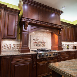 Showroom 2013 - Dynasty by Omega Cabinetry in Artesia door style, Cherry wood with a Sable finish. Granite in Amber Fantasy.
