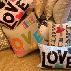Love lettering graphic Word Cotton Throw Pillows - Whether its Valentine's season or you just want to remember what's important, these eclectic LOVE pillows lighten the mood in any room of your home, whether it's in a girly girl's bedroom or your sweetie's sofa.