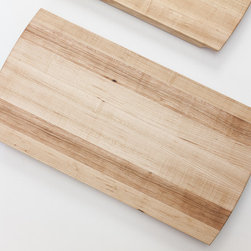 Eidolon Chopping Block - This cutting board exemplifies ergonomic, sophisticated design. Edge-grained Hard White Maple is a premium surface for preserving blade sharpness. The rounded Eidolon ogee handles at each end make transport safe and easy while offering a sleek overhang for raking off choppings. Large non-slip polyurethane bumpers are secured to the bottom of the board. Stains used for coloration of ends are water-soluble powders, which are sealed with a high-performance waterborne acrylic urethane. Stain and sealer are both non-toxic. Overall food grade mineral oil finish. An occasional disinfectant spray after cutting poultry and meats is advised, along with a food-grade mineral oil rub down whenever the maple looks dry.