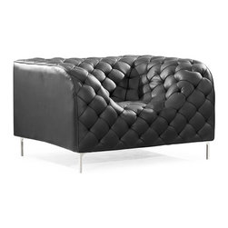 End Scene Chair in Black - Wrapped in leather and tufted for texture, the End Scene Chair leaves a lasting impression. Like all unique stories, the chair is simply unforgettable.