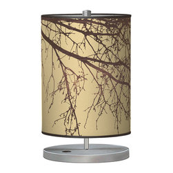 jefdesigns - Branch 2 Cylinder Table Lamp - Dark autumnal branches, against a backdrop of gold, enhance this cylindrical table lamp's glow, making it just the right addition your bedroom. Conceived by Portland designer Joe Futschik, its printed linen shade and circular metal base will provide you with just the right glow.