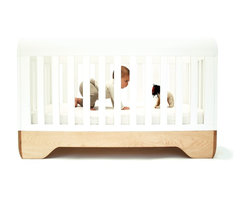 Kalon Echo Crib - Made of 100% solid FSC-Certified domestic Maple and finished with water-based paint, the Echo Crib by Kalon celebrates the quintessential form of the crib. The Echo crib is more than a crib. The continuous lines of the piece create a sculpted, fluid form.