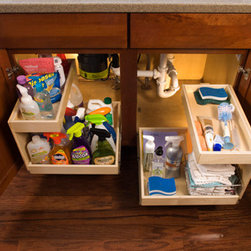 Slide Out Shelves with Risers - Organize your under-sink cabinets with slide out shelves with risers.  The risers are custom made, just like all of our slide out products, and are designed to provide an additional layer of storage that fits around your under-sink plumbing.