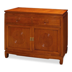 China Furniture and Arts - Rosewood Longevity Design Sideboard - This handsome solid rosewood cabinet features the Chinese symbol of longevity on the doors and drawers. All hand carved with traditional Chinese joinery techniques. A removable shelf is behind the brass-handled doors, providing ample storage space. Wonderful for dining room or bedroom storage. Hand applied natural rosewood finish.