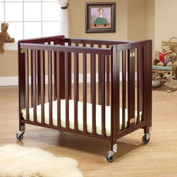 Orbelle Lilly Portable Crib - Cherry - Featuring a headboard and footboard crafted of solid wood more than one-inch thick, the Orbelle Lilly Portable Crib - Cherry is an ideal and safe crib that can be moved easily from room to room. It's easy to assemble, too, and comes with all the necessary tools needed. It also comes with a two-inch anti-microbial mattress with fasteners and smooth plastic teething rails that protect you child and well as preserve the crib. It features anti-pinch hinges for quick and safe folding for easy storage. This crib is approved for use in daycare facilities, hospitals and schools.About Orbelle TradeBegun in Brooklyn, NY, in 1991, Orbelle has grown into a leading baby and teen furniture business, still family owned and operated. Fast shipping and quality furniture with exclusive designs and colors keep Orbelle at the forefront of baby and kids lines of furniture.