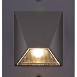 "Lamps Plus - Contemporary Bronze Trapezoid 4 1/2"" High LED Outdoor Step Light - This beautiful rectangular downlight in bronze finish die-cast aluminum illuminates outdoor stairs steps or pathways. The trapezoid shape Solite glass lens is lit by energy-saving LEDs and extends from the wall plate. Wet location rated for outdoor use; fits over a standard single switch box. Line voltage. By Creative Systems Lighting. Bronze finish die-cast aluminum outdoor step light. Trapezoid shape Solite glass lens. Includes one 3 watt LED. Color temperature is 2850K. 120v input driver. 4 1/2"" high. 3"" wide. Extends 1 1/2"".  Bronze finish die-cast aluminum outdoor step light.   Trapezoid shape Solite glass lens.   Includes one 3 watt LED.   Color temperature is 2850K.   120v input driver.   Line voltage.  4 1/2"" high.   3"" wide.   Extends 1 1/2""."