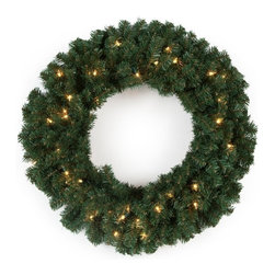 East West Basics (HK) Ltd - 24 in. Classic Pine Pre-lit Wreath Multicolor - TI920-300BE-50LC - Shop for Holiday Ornaments and Decor from Hayneedle.com! The Classic 24-inch Pre-Lit Wreath will warm your home just in time for the holidays. This wreath is perfect for hanging above the fireplace mantle or for adorning an empty wall. Lush pine foliage is densely packed with 300 tips and strung with 50 clear lights to bring cheerful ambient light that staves off the winter darkness. Simply leave this wreath undecorated or trim with your favorite ornaments for a personalized display. Cord Length on wreath is 28 inches long.Place your order today to enjoy lively green and welcoming light in your home this holiday season.