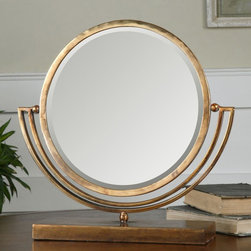 Uttermost - Uttermost Hadriana Gold Vanity Mirror - 15 diam. in. - 12893 - Shop for Bathroom Mirrors from Hayneedle.com! The Uttermost Hadriana Gold Vanity Mirror - 15 diam. in. is an ideal choice for the dresser bedside table or master bathroom. This double-sided mirror easily adjusts between a beveled side and smooth side within a marvelous framework of hand-forged metal in heavily antiqued plated gold.About UttermostThe mission of the Uttermost Company is simple: to make great home accessories at reasonable prices. This has been their objective since founding their family-owned business over 30 years ago. Uttermost manufactures mirrors art metal wall art lamps accessories clocks and lighting fixtures in its Rocky Mount Virginia factories. They provide quality furnishings throughout the world from their state-of-the-art distribution center located on the West Coast of the United States.