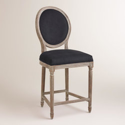 World Market - Black Paige Counter Stool - A classic with a round back silhouette, our Black Paige Counter Stool is crafted of American white oak with carved details and a distressed finish. Pull this exclusive velvet upholstered stool up to the bar or kitchen for a stylish seating update.
