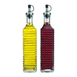 Storage Essentials Ribbed Glass Oil and Vinegar Cruet, Set of 2 - Store a multitude of condiments in a convenient and practical way with this set of two glass oil and vinegar cruets. Each dispenser has a 17 ounce capacity and comes with a metallic spout with a black cap for easy pouring. A must for a any household, the cruets utilize a fashionable ribbed glass design, which also allows for easy gripping and expert use.