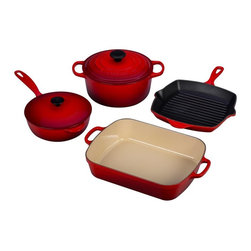 Le Creuset - Le Creuset Cherry 6 Piece Signature Set - MS1406-67 - Shop for Cookware Sets from Hayneedle.com! Red sports cars may get more tickets but the Le Creuset Flame 6 Piece Signature Set just gets more clean plates and adulation. Enjoy cooking with cast iron a material you can trust to distribute heat evenly even for hours of low slow cooking. Le Creuset makes cast iron fun with its signature: colorful easy-care enamel finishes that don't crack or chip. You won't even need to season them or break them in. Cast iron is also legendary for heat retention allowing food to stay hot longer. Tight-fitting lids lock in heat and flavor while all handles are designed for safe secure handling by oven-mitted hands. And while cast iron is heavy Le Creuset is proud to bring you the lightest cast iron per quart on the market. Sand-colored enamel on the roaster saucier and French oven's cooking surfaces assist you in visual identification of perfectly done dishes. This hardy finish is also engineered to resist burning sticking dulling and staining. The skillet grill bears a Satin Black enamel finish that is designed for cooking at higher temperatures and does not need seasoning prior to use. All pieces wash up nicely with warm soapy water.Additional Features:Saucier knob is heat safe to 375 FFrench oven knob is heat safe to 500 FSet weighs 38.8 lbs.4 1/2 Qt. French Oven measures 6.75H x 10 diam. in.5 1/4 Qt. Roaster measures 15.75L x 10.25W x 3H in.Square Skillet Grill offers a 10W x 10L x 1.75H in. cooking surface5 1/4 Qt. Roaster measures 16.5L x 95W x 5H in.Made in FranceAbout Le Creuset of America Inc.From its cast iron cookware to its teakettles and mugs Le Creuset is a global standard of inimitable color and quality. Founded in 1925 in the northern French town of Fresnoy-Le-Grand Le Creuset still produces enameled cast iron in its original foundry. Its signature color Flame was modeled after the intense orange hue of molten cast iron within a cauldron (or creuset in French) and has been a Le Creuset bestseller from the company's first year to the present day.Though best known for its vibrantly colored cookware and original inventions such as the Dutch oven Le Creuset has also forged a name as a creator of stoneware mugs and enamel-coated stainless steel teakettles. The style and performance of Le Creuset's Cafe Collection and tea accessories are rooted in classic French cookware: bold colors cylindrical loop handles unmatched thermal resistance and heat distribution and of course the iconic Le Creuset three-ring accent. Through its consistent qualities of authenticity originality and innovation Le Creuset maintains a connection to both heritage and modernity.