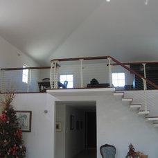 Contemporary Staircase by Keuka Studios, Inc