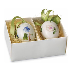 ROYAL COPENHAGEN - Royal Copenhagen Porcelain Ornaments - Add a lovely touch to your decor with these porcelain-constructed ornaments from Royal Copenhagen. A flower detailing highlight this set of two egg-shaped ornaments.