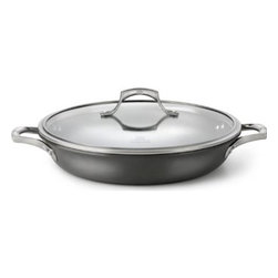 "Calphalon - Calphalon Unison Sear Non Stick Everyday Pan with Lid 12"" - The specially textured Calphalon Unison SEAR Non Stick surface seals in flavor and is ideal for sauteed vegetables, braised beef, chops and cutlets and pan sauces. The wide flat-bottom surface is ideal for searing and low sides allow air to circulate so that foods remain crisp, yet high enough to contain juices and prevent splattering. Low sides allow air to circulate so that foods remain crisp, yet high enough to contain juices and prevent splattering. Heavy-gauge hard anodized aluminum. Spun or drawn construction provides superior conductivity and even, consistent heat. Will not chip, crack and warp. At last, Non Stick cookware that lets you cook like a professional. Free your culinary spirit, try a new recipe or improvise your own creation - Sear Non Stick makes it easy to express your culinary creativity. The specially textured Sear Non Stick surface has the searing capability that true chefs demand from professional-grade cookware, yet all the convenience of Non Stick. Cast, brushed stainless steel. Ergonomic, stay-cool handles. Triple-riveted for durable performance. Domed, tempered glass with stainless steel rim Oven safe up to 500 F degrees / 260 C degrees Cleaning. Before using for the first time, wash in warm, sudsy water. For hand washing, use a liquid dishwashing detergent such as Dawn and a sponge or soft bristle brush. For automatic dishwashing detergent, we recommended Cascade. To remove spots or stains from the hand anodized exterior use the recommended liquid dishwashing detergent and a non-abrasive pad or sponge. Allow to cool before cleaning. Never immerse a hot pan in cold water; doing so can cause irreparable warping. Dishwasher For the perfect pair, look for Calphalon Unison cookware with Slide Non Stick. Its revolutionary, ultra-smooth Slide Non Stick surface releases foods effortlessly, essential for creating tender omelettes and delicate sauces. Lifetime warranty.."