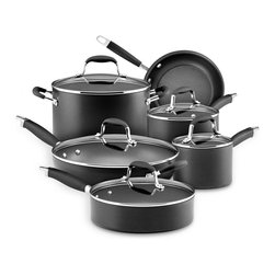 "Anolon Advanced 11 Piece Cookware Set - This Analon Advanced 11 piece cookware set is an exceptional value  including every essential piece of cookware your kitchen truly needs. You could be set for life - breakfast  lunch and dinner. From sunrise to sunset  from simple family meals to elegant entertaining  this set covers the bases  giving you gourmet performance at home. Nonstick interior is metal utensil-safe.These metal utensil safe Anolon�� Advanced pots and pans feature revolutionary ergonomic SureGrip_�� handles  a combination of durable stainless steel and silicone rubber  that provide a confident yet soft grip and are oven safe to 400 DegreesF. The pans' heavy gauge  hard-anodized construction ensures efficient  even heat distribution for exceptional gourmet cooking performance. DuPont's rugged Autograph�� 2 nonstick surface inside and out is ideal for both healthy cooking and easy cleanup. Restaurant tested by professional chefs  Autograph�� 2 surpasses all other standard nonstick formulas by delivering superior durability that stands up to the rigors of a professional kitchen.Set Includes                        1.5 Qt. Covered Saucepan            3 Qt. Covered Saucepan            8 Qt. Covered Stockpot            8.5 "" Skillet            12 "" Covered Deep Skillet            3 Qt. Covered Saute                        Product Features                        Material - Hard Anodized Aluminum            Oven Safe to 400 Degrees F            Suitable stovetop - Gas  solid plate  radiant ring  ceramic  halogen            Nonstick interior surface            Dishwasher Safe - No            Lifetime Limited Warranty"