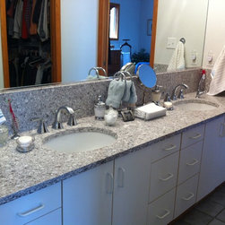 Bathroom Updates, Lodi, OH #1 - This bathroom was updated by keeping the existing cabinets and installing Caesarstone Quartz Vanity Tops in Atlantic Salt with backsplash and side splashes.  Also installed are two white single bowl undermount sinks accented with Moen Voss Chrome Faucets.