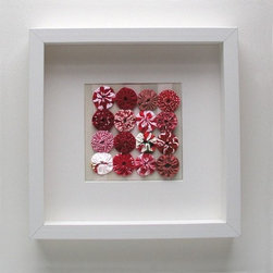 "Framed Quilted Yo Yo Set in Reds by Robayre - These little quilted fabric pinwheels are called ""yo-yos,"" and they are almost as fun as their toy counterparts. This red version would make a cute Valentine's Day decoration. It's available in other colorways too, and it would be fun art for a nursery wall."